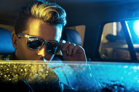 Handsome young man wearing modern sunglasses Stock Photo