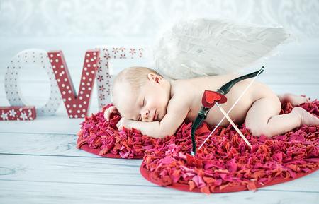 Portrait of a cute sleeping cupid