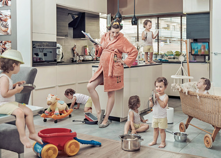 mess: Conceptual image of exhausted mum with her misbehaving child