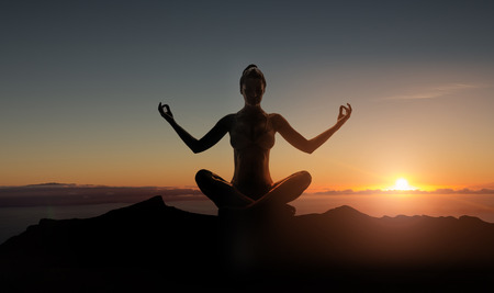 lady silhouette: Silhouette of a young meditating lady
