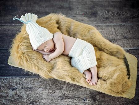 1: Cute little, newborn baby sleeping on the soft blanket
