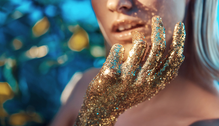 shine: Conceptual portrait of the land with golden hands