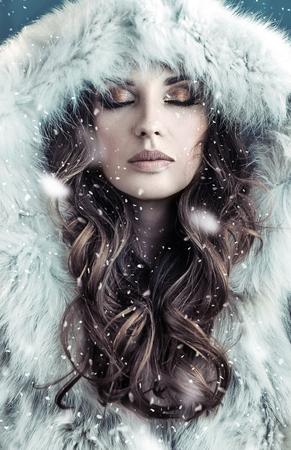 long: Portrait of a brunette woman wearing hooded fur coat