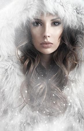 long: Portrait of a calm lady winter wearing a fur coat