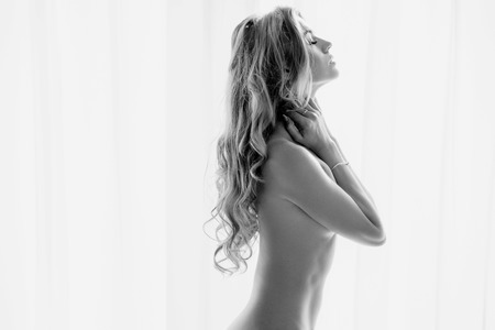 young woman nude: Art portrait of a fresh, relaxed young lady
