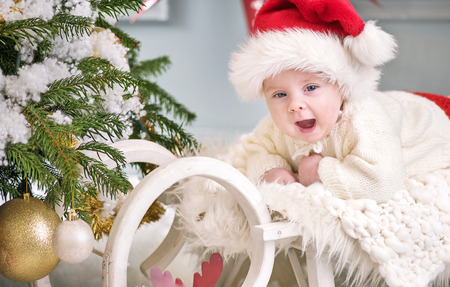 Portrait of a cute litle son celebrating Christmas Stock Photo