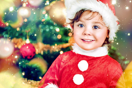 Closeup portrait of a cute little santa girl Stock Photo