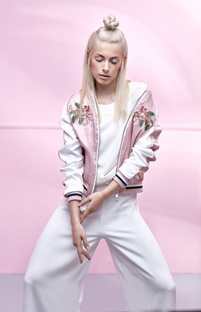 Pretty, delicate girl wearing trendy jacket Imagens - 72681644