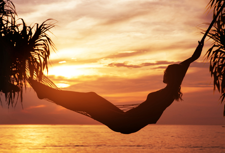 Portrait of a young, attractive lady watching a sunset Stockfoto