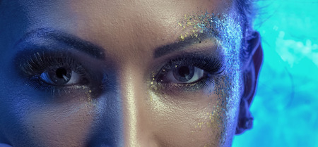 eye makeup: Closeup portrait of a lady with golden gust on the face