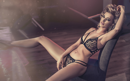 blue lingerie: Portrait of a tired blond lady wearing lacy lingerie Stock Photo