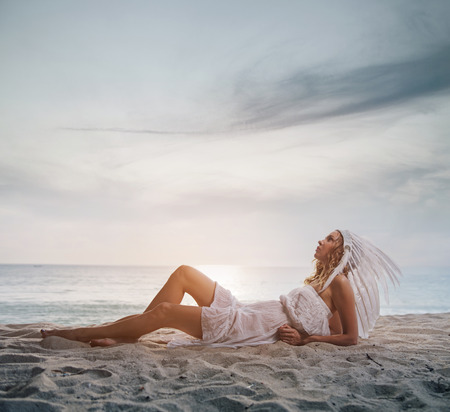 Blond lady wearing a white, ostrich plume Stock Photo