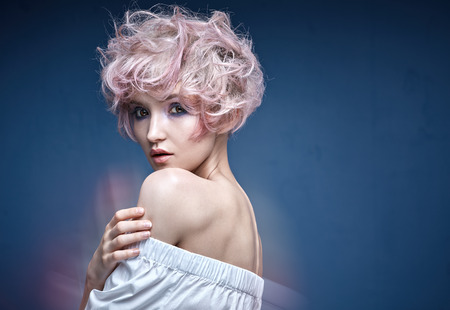 hair stylist: Closeup portrait of a cute lady with a pink hairstyle Stock Photo