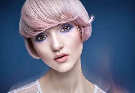 Closeup portrait of a girl with a stylish pink haircut Stock Photo