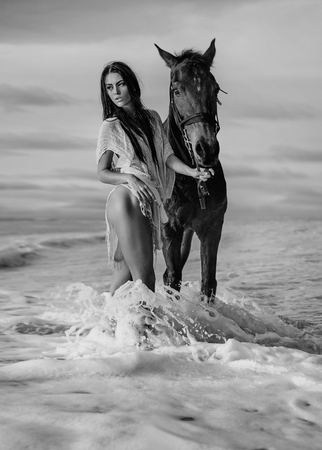 Black&white portrait of a model with a stallion Stock Photo