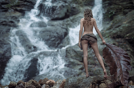 Nude lady watching the waterfalls