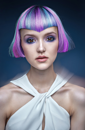 Portrait of a young lady with a colorful hairstyle