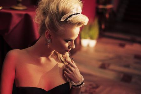 Portrait of a blond, voluptuous maid