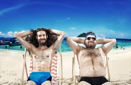 Two funny friends resting on the beach