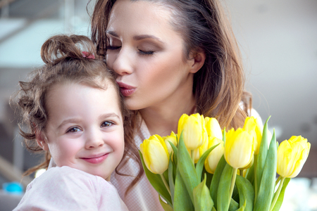 Portrait of pretty mother with a beloved daughter