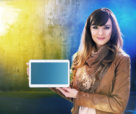 communication: Attractive young woman holding a tablet Stock Photo