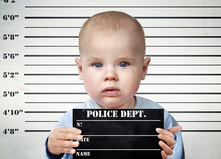 Little infant on a prison board Stock Photo