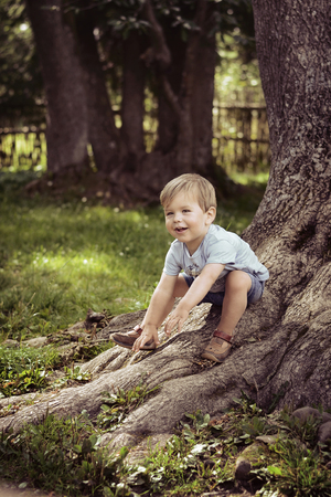 Cheerful, cute boy playing in the park