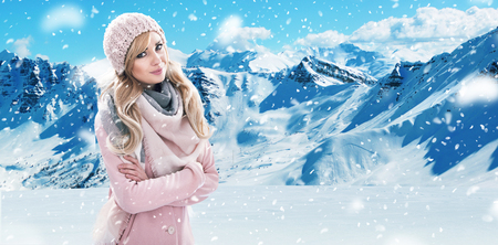 winter fashion: Pretty blond lady with white mountains in the background