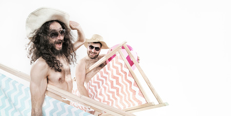 Two geek guys on the beach - isolated Stock Photo