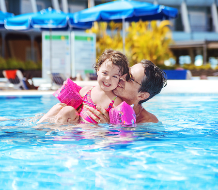 sunbath: Handsome father swimming with a cute daughter Stock Photo