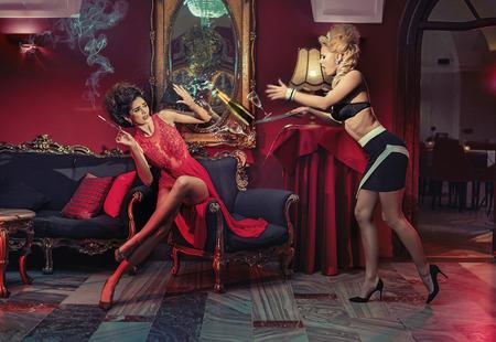 Retro party, two sensual, stylish women