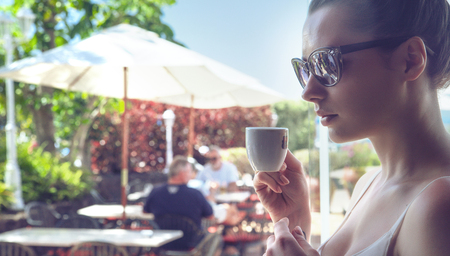 tea hot drink: Portrait of an attractive woman drinking a coffee