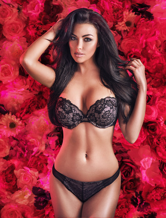 Voluptuous young lady over the red rose background