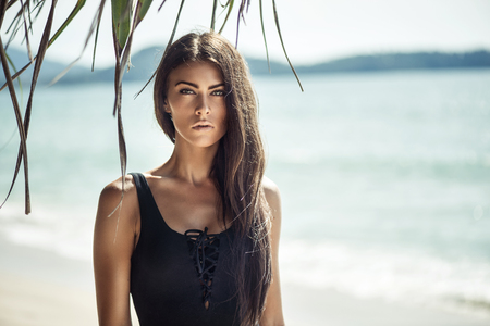Portrait of a young, alluring woman on a tropical beach