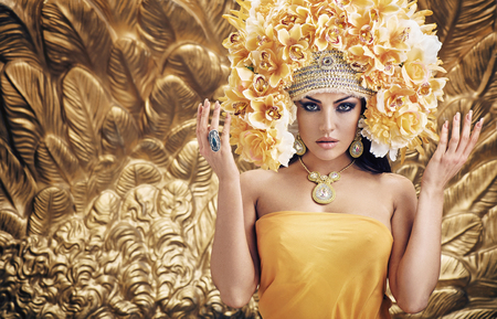 Golden, pretty queen over the golden background