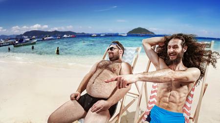 Two funny geek friends taking a sunbath