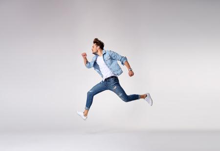 Stylish, handsome guy running - isolated
