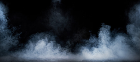 abstract backgrounds: Image of dense smoke swirling in the dark interior