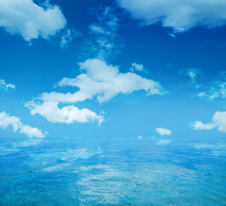 Infinite water surface over the blue sky background