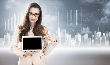 Business style photo of a lady holding a tablet