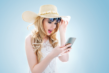 Portrait of an elegant young lady using a mobile phone Archivio Fotografico