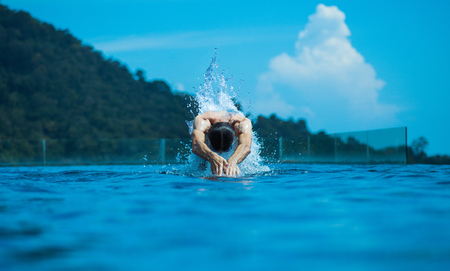 Young, fit athlete swimming in the ocean photo