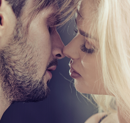 Closeup portrait of a kissing couple in love