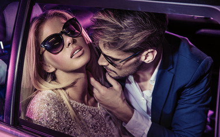 Nightlife - handsome man seducing a beautiful woman