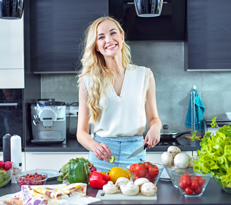 Cheerful blonde making a helathy, light lunch Stock Photo