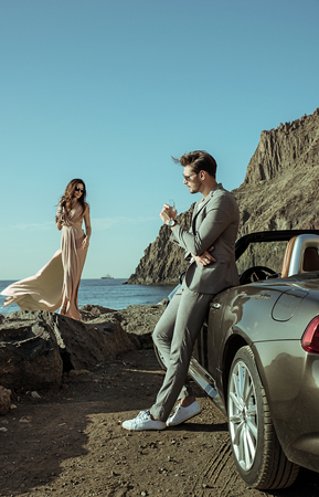 Young, elegant couple on the luxurious vacation 스톡 콘텐츠