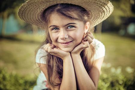 Summer portrait of a pretty, smiling child