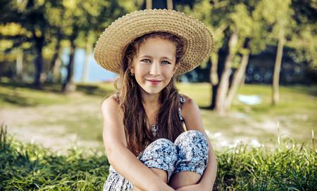 Cheerful child resting on fresh, summer lawn