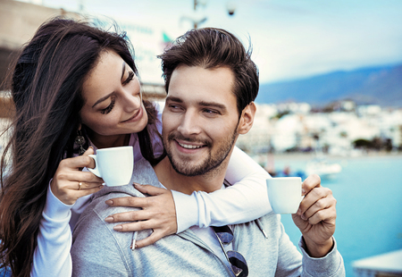 Romantic, young couple drinking a mornig cup of coffee