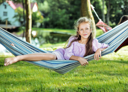 Cheerful girl resting on the comfortable hammock Reklamní fotografie